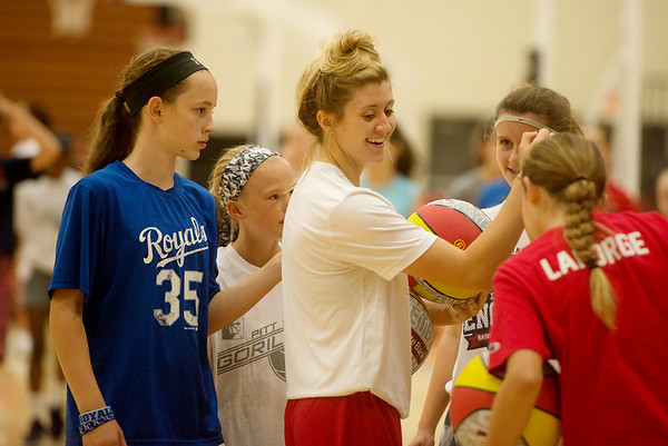 Pittsburg State freshman Tristan Gegg works with campers during a basketball camp at John Lance Arena on Tuesday.<br /> Globe | Roger Nomer