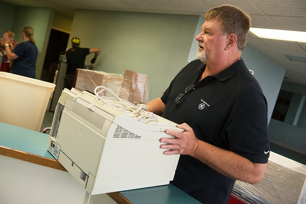 Robert Schuchmann helps pack up office equipment to be sent to Kenya on Friday morning.<br /> Globe | Roger Nomer