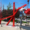 Workers install the newest Jorge Leyva sculpture in Chicago.<br /> <br /> Photo credit goes to Jorge Leyva