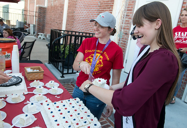 Izzy Smiley, 17, left, and Miss Columbus Morgan Cassidy, 18, serve birthday cake for the 150th celebration in Columbus on Saturday.<br /> Globe   Roger Nomer