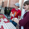 Izzy Smiley, 17, left, and Miss Columbus Morgan Cassidy, 18, serve birthday cake for the 150th celebration in Columbus on Saturday.<br /> Globe | Roger Nomer