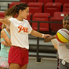 Pittsburg State freshman Syd Crain works with Miriam Fleming, 12, during a basketball camp at John Lance Arena on Tuesday.<br /> Globe | Roger Nomer