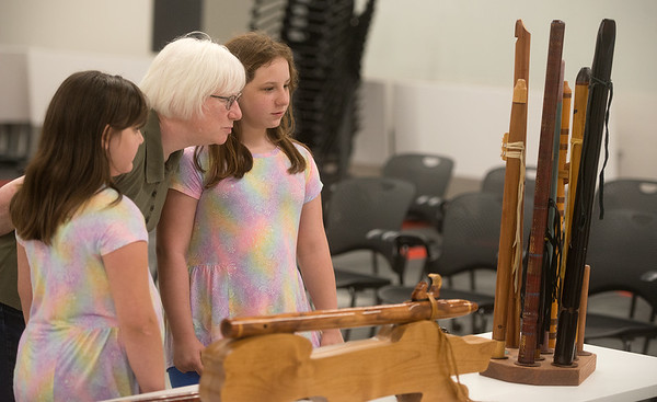 Pam Carrier and her granddaughters Josephine, 9, left, and Lillian Testerman, 10, look at flutes at the Joplin Public Library on Tuesday.<br /> Globe   Roger Nomer