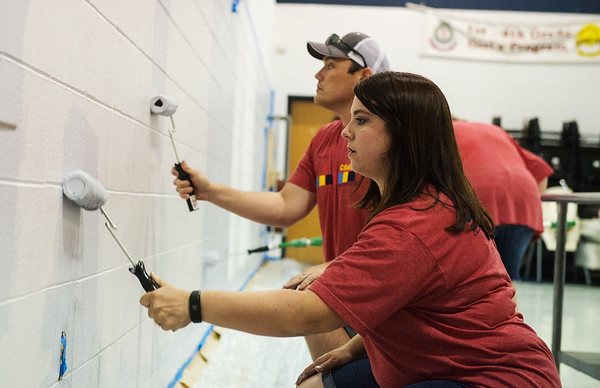 Shanna Boyes and Kayle Scott, with Liberty Utilities, paint a wall at the Joplin Salvation Army on Friday as part of the United Way Day of Caring.<br /> Globe | Roger Nomer