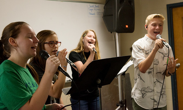 (from left) Lydia Randleman, 15, Mebra Hays, 15, Tannie Jones, 16, and Haddon Spikereit, 16, practice a song during Ozark Christian College's Creative Arts Academy on Thursday. Students at the art camp will hold a final presentation on Friday at 4 p.m. at the OCC chapel.<br /> Globe | Roger Nomer