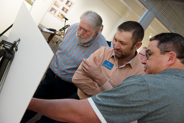 (from left) Joplin Mayor Gary Shaw, Eric Secker and Chad Evans look at designs for the proposed Cornell Complex on Friday at the Spiva Center for the Arts.<br /> Globe   Roger Nomer