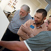 (from left) Joplin Mayor Gary Shaw, Eric Secker and Chad Evans look at designs for the proposed Cornell Complex on Friday at the Spiva Center for the Arts.<br /> Globe | Roger Nomer