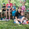 Thomas Hamilton, 4, and his mother Lucy Phelps, Joplin, listen to a story about baby animals during a class at Wildcat Glades on Wednesday.<br /> Globe | Roger Nomer