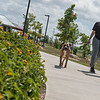 Miranda Amayrani, Overland Park, walks her dog Euro at Mercy Park on Wednesday.<br /> Globe | Roger Nomer