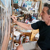 Local artist Andy Thomas works in his Carthage studio on June 6.<br /> Globe | Roger Nomer
