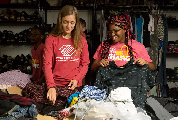 Faith Cook, teen coordinator of the Boys and Girls Club of Southwest Missouri, left, and Sha'leeah Travis, 14, volunteer at Souls Harbor on Tuesday.<br /> Globe   Roger Nomer