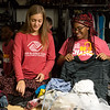 Faith Cook, teen coordinator of the Boys and Girls Club of Southwest Missouri, left, and Sha'leeah Travis, 14, volunteer at Souls Harbor on Tuesday.<br /> Globe | Roger Nomer