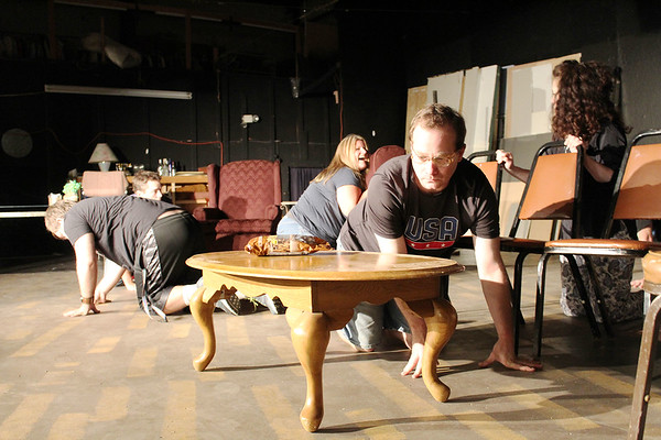 """Cast members act out a funny moment as they roam the stage on hands and knees during rehearsals of """"Rumors,"""" the latest Stone's Throw Theatre production."""