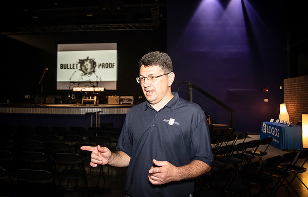 Globe/Anne Brown<br /> Reg Givens, elder and pastor of Grace Place near Lamar, makes a point prior to the opening of the church-sponsored men's conference, Bulletproof, last week at Victory Ministry and Sports Complex in Joplin.