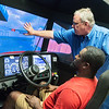 Marco Johnson, a Crowder student from Lakeland, Fla., works with Darrin Pfeifly, director of Crowder Transport Training, on a driving simulator on Thursday at Crowder.<br /> Globe | Roger Nomer
