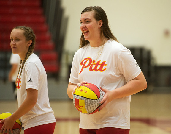 Pittsburg State freshman Megan Scott works with campers during a basketball camp at John Lance Arena on Tuesday.<br /> Globe | Roger Nomer