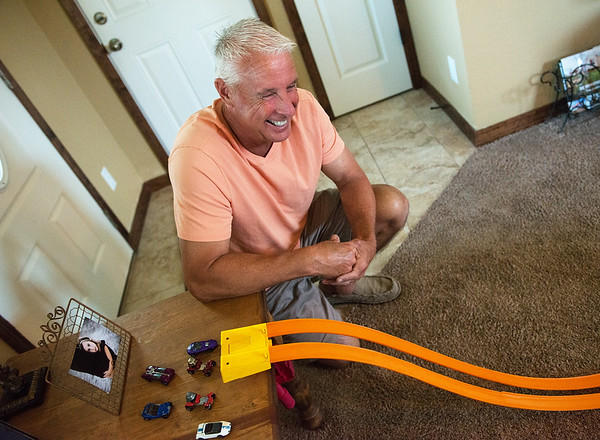 Jay McBee talks about collecting Hotwheels and racing tracks during an interview on Tuesday.<br /> Globe | Roger Nomer
