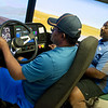 Darrin Cook, a Crowder student from New Orleans, works with Rufus Kelly, transport training instructor, on a shifting simulator on Thursday at Crowder.<br /> Globe | Roger Nomer