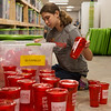 Lydia Anker, 14, sorts merchandise at Rapha House while volunteering with the Youth Volunteer Corps on Tuesday.<br /> Globe | Roger Nomer