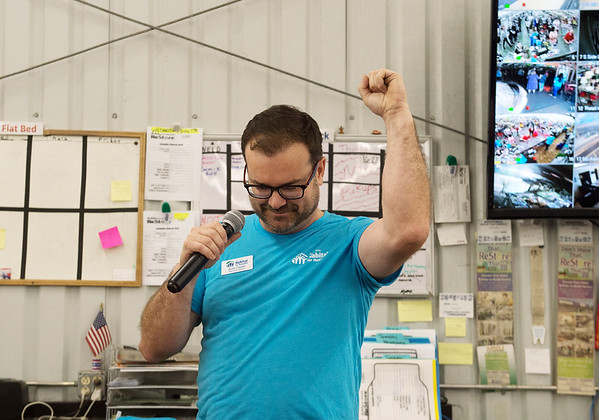 Scott Clayton, executive director of Joplin Habitat for Humanity, gives a salute to the volunteers who have built houses over the past 30 years during Thursday's anniversary party at the Habitat ReStore.<br /> Globe | Roger Nomer