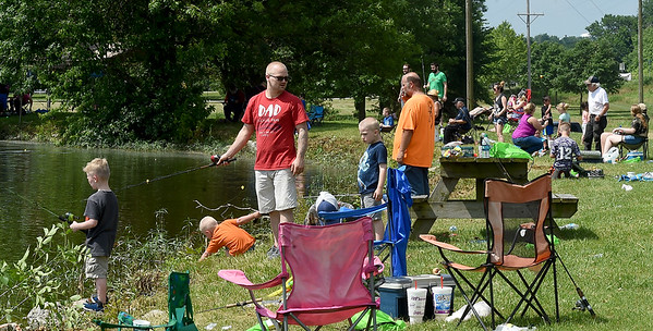 Anglers of all ages line the banks of Kellogg Lake hoping for a fish during the annual Kids Fishing Day on Saturday at Carthage's Kellogg Lake. The annual event featured free fishing, educational booths, free lunch and more.<br /> Globe | Laurie Sisk