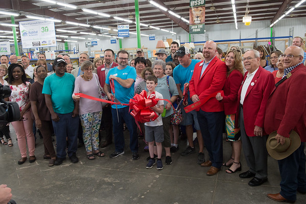 A ribbon is cut to honor the 30th anniversary of Joplin Habitat for Humanity on Thursday at the Habitat ReStore.<br /> Globe | Roger Nomer