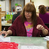 Sandy Hill folds instruction books at the Joplin Workshops on Friday.<br /> Globe | Roger Nomer