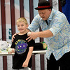 Seven-year-old Kamren Tucker eacts to the antics of comedian, juggler and magician Oh My Gosh Josh during a performance on Thursday at the Joplin Public Library. Oh My Gosh Josh, also known as Joshua Routh, of Circus Kaput, helped kick off the summer reading program at the library.<br /> Globe | Laurie Sisk