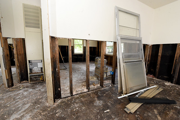 Portions of drywall have been to removed in an effort to rehabilitate this house on the 1100 block of Central Ave. in MIami on Wednesday.<br /> Globe | Laurie SIsk