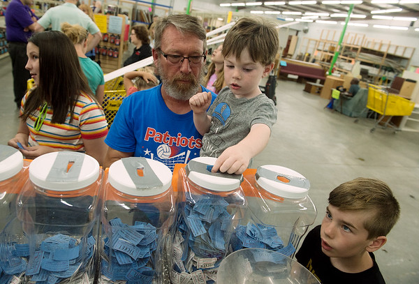 Marvin Heckart, and his grandchildren Griffin, 3, and Connor Jordan, 11, enter a raffle during Joplin Habitat for Humanity's 30th anniversary party at the Habitat ReStore on Thursday.<br /> Globe | Roger Nomer