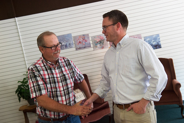 James Loncarich, associate with Hurst-Rosche, Inc., left, talks with Jake Heisten, director of Grow Neosho, in downtown Neosho on June 21.<br /> Globe | Roger Nomer