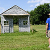 Steve Maddox walks near a mock up of what the Rader house probably looked like during the Civil War. The house is located at the Sherwwod-Rader Farm near Carl Junction.<br /> Globe | Laurie SIsk