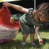"""i'm taking care of God's earth,"" said four-year-old Layla Craven, of Joplin, as she foregoes the fishing to pick up litter during the annual Kids Fishing Day on Saturday at Carthage's Kellogg Lake. The annual event featured free fishing, educational booths, free lunch and more.<br /> Globe 