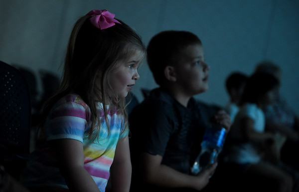 """Maddie, 3, and Jax, 7, Hoskins watch """"Wreck It Ralph"""" during Friday's Summer Movie Break at the Joplin Public Library.<br /> Globe 