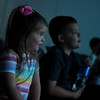 "Maddie, 3, and Jax, 7, Hoskins watch ""Wreck It Ralph"" during Friday's Summer Movie Break at the Joplin Public Library.<br /> Globe 