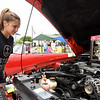 Ten-year-old Lily Glover checks out the engine on a 2001 Mustang owned by Mark Baron, of Goodman during the Carterville Car and Motor Cycle Show on Saturday at Carterville's Comets Park. The event also featured vendors, music and food.<br /> Globe | Laurie Sisk