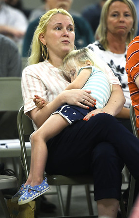 Charity Rogers, 32, holds her three-year-old daughter Avery Purdy as she discusses her health concerns at the Miami Civic Center on Thursday night during an informational meeting involving the clean up of asbestos at the BF Goodrich plant in Miami. <br /> Globe | Laurie Sisk