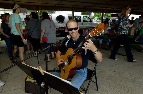 Musician Drew Pommert entertains the crowd at the Webb City Farmers Market on Tuesday during Eat Street at the Market, a special night filled with music, food trucks and special activities each third Tuesday of the month through October.<br /> Globe | Laurie SIsk
