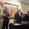 (from left) Sen. Bill White, Rep. Lane Roberts, Clifford Wert and Sharon Beshore watch as Missouri Lt. Gov. Mike Kehoe signs Senate Bill 397 on Monday at the Spiva Center for the Arts.<br /> Globe | Roger Nomer