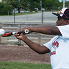 Joshua Goodwin, 11, connects with a bunt during Wednesday's Outlaws youth camp at Joe Becker Stadium.<br /> Globe | Roger Nomer