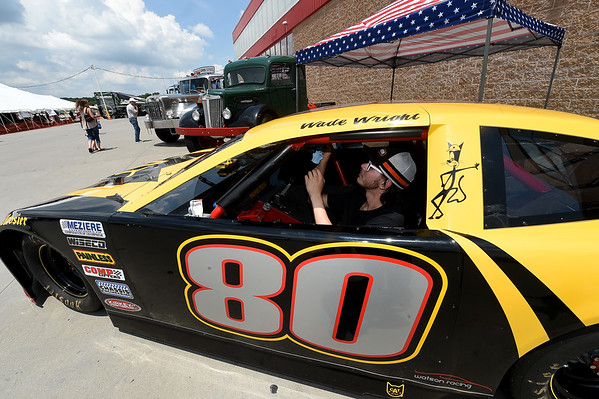 Dakota Ferguson, of Hammerland Trucking, helps detail the inside of Brad Watson's 2019 Camaro ZR1 during the Truckers Jamboree on Friday at Petro. The two-day event continues today with music, displays, a petting zoo, fireworks and more.<br /> Globe | Laurie SIsk
