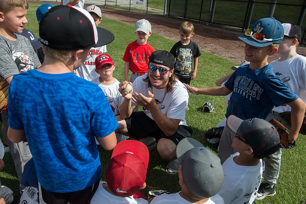 Outlaws player Alec Capshaw talks to a group of kids during the Outlaws youth camp on Wednesday at Joe Becker Stadium.<br /> Globe | Roger Nomer