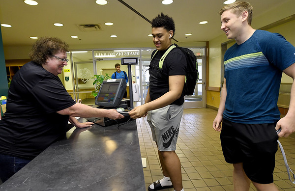 "From the left: Denise Terry, affectionately known as ""Momma D"" to Missouri Southern students, visits with MSSU football players Dylan Wright and Gibson Beyer in the Mayse Dining Hall on Wednesday. Terry was recently honored by the MIAA for her service to student athletes. <br /> Gkobe 
