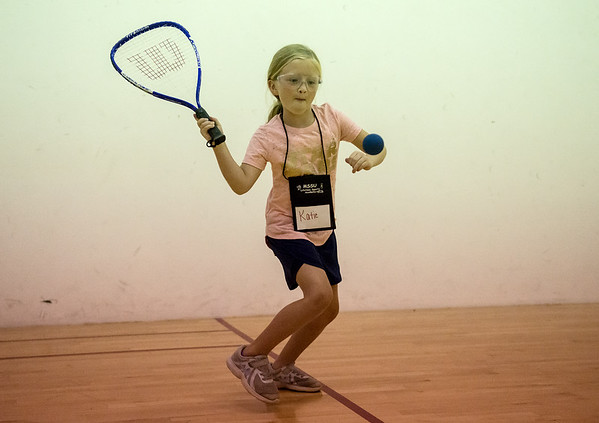 Katie Patterson, 8, Joplin, plays racquetball during Tuesday's Lifetime Sports Academy at Missouri Southern. The summer sports camp is held by the kinesiology department at MSSU, and introduces children to sports they can continue to play througout their life.<br /> Globe | Roger Nomer