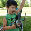 Five-year-old Wyatt Morales, of Carthage, reacts as he pulls in a perch during the annual Kids Fishing Day on Saturday at Carthage's Kellogg Lake. The annual event featured free fishing, educational booths, free lunch and more.<br /> Globe | Laurie Sisk