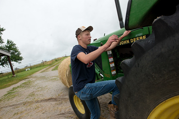 Dylan Gallup, 16, works on his family's farm in Lockwood on Monday.<br /> Globe | Roger Nomer