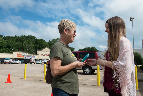 Shay Moser, teller, right, helps Sally Cummings with a deposit at US Bank in Neosho on Friday.<br /> Globe | Roger Nomer