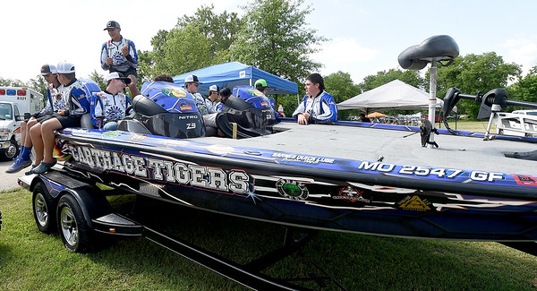 Members of the Carthage High School bass fishing team gather around their team boat during the annual Kids Fishing Day on Saturday at Carthage's Kellogg Lake. The annual event featured free fishing, educational booths, free lunch and more.<br /> Globe | Laurie Sisk