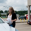 Krystal Lewis, assistant manager, helps a customer outside US Bank in Neosho on Friday.<br /> Globe | Roger Nomer