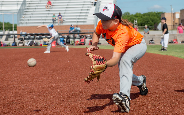 Cooper Tingle, 10, tracks down a ground ball during Wednesday's Outlaws youth camp at Joe Becker Stadium.<br /> Globe | Roger Nomer